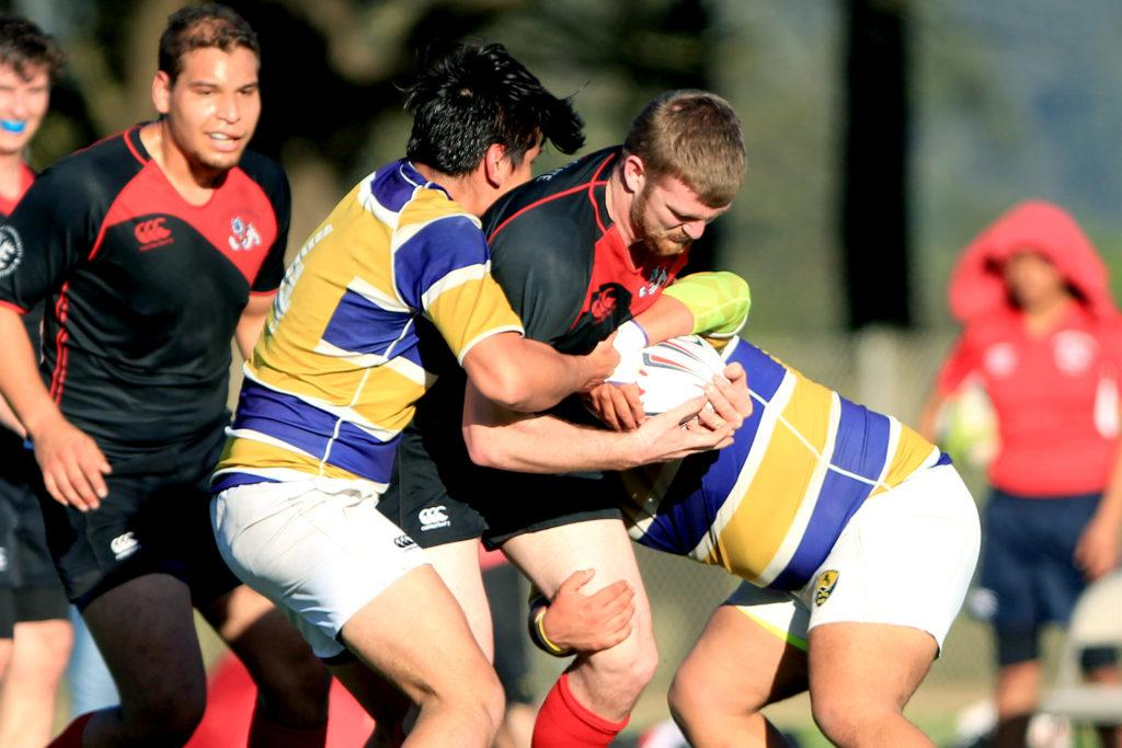 Fresno State lock Antonio Guerra (5) tries to escape a tackle during a rugby match against SF State at Gellert Field in Daly City, Calif., on Saturday, Feb. 3, 2018. (Christian Urrutia/Golden Gate Xpress)