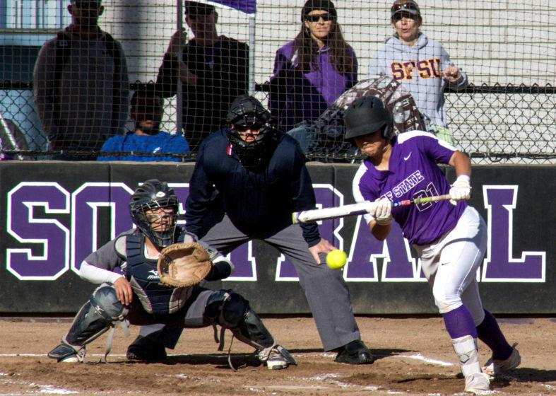 Sara Higa (21) attempts a bunt during the game against Notre Dame de Namur at SF State on Monday, Feb. 19, 2018. (Jordi Molina/Golden Gate Xpress)