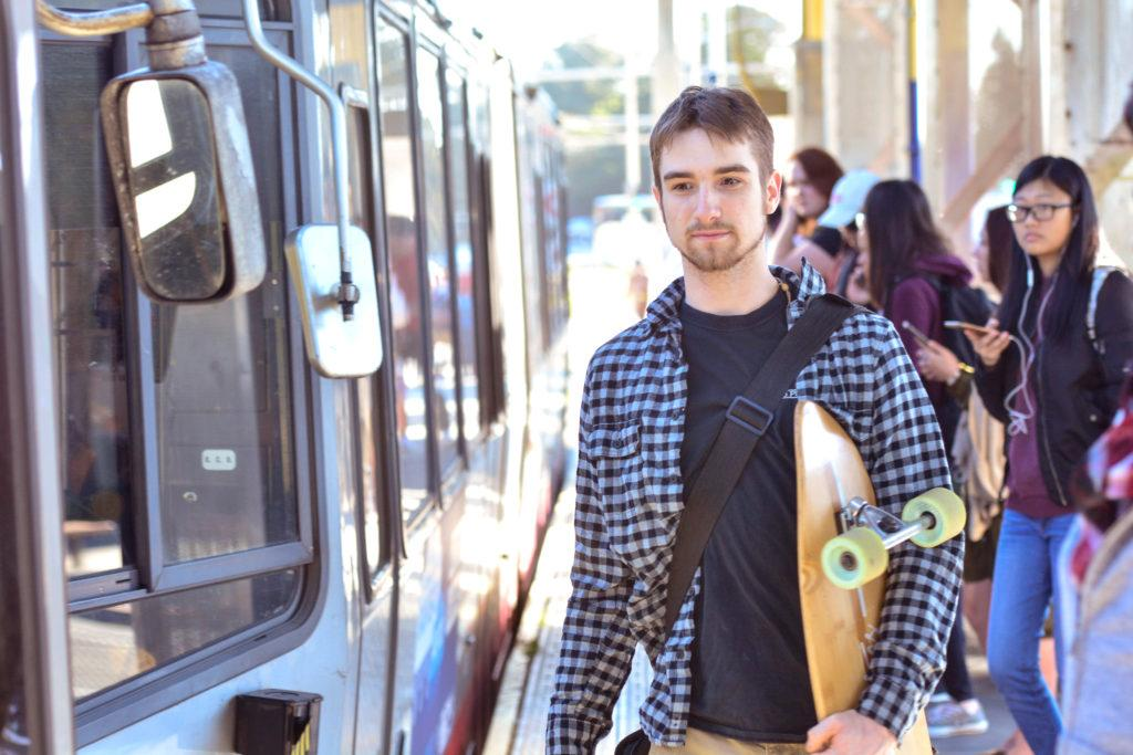 Robert Pleimling is about to get on the inbound Muni M line at SF State on Tuesday, Feb. 6, 2018. (Bryan Ramirez/Golden Gate Xpress)