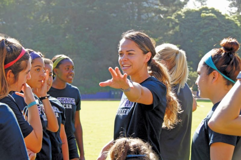 SF State alumni Myria Johnson speaks to the alumni team before the game versus the current women's soccer team at SF State, Saturday, Feb. 10, 2018. (Aya Yoshida / Golden Gate Xpress)
