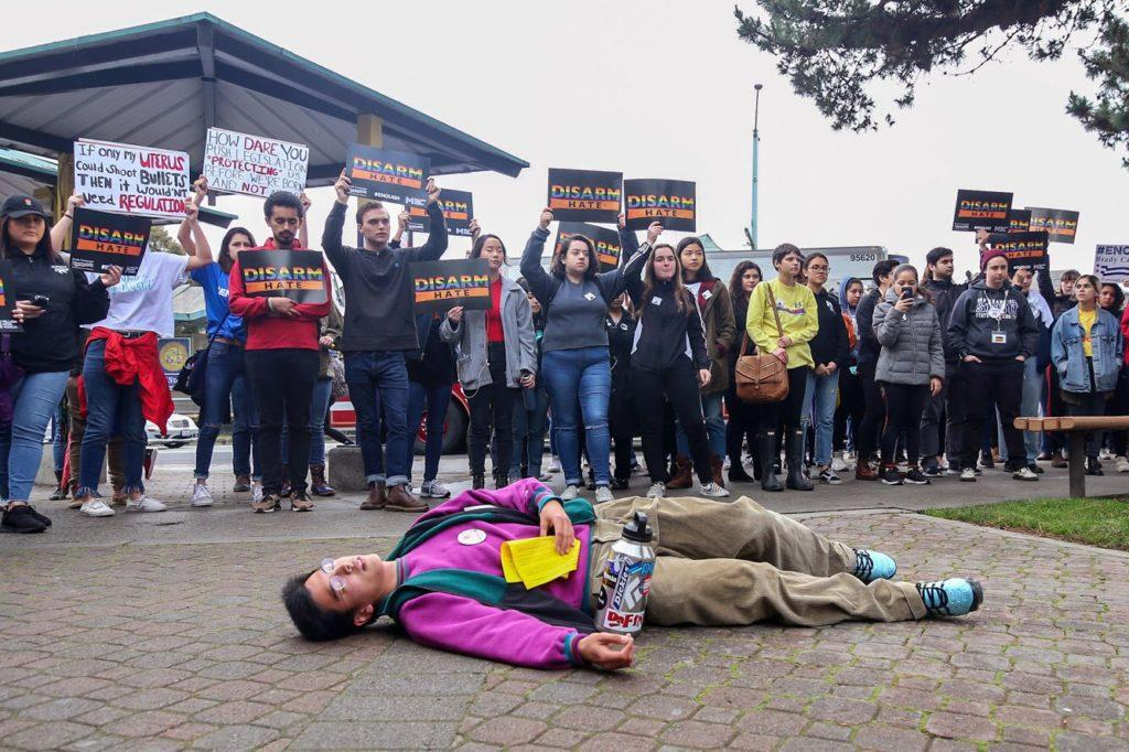 In representation of the students who have passed away due to gun violence, Ernest Li lies down on the floor at SF State during a moment of silence of the walkout on Wednesday, March 14, 2018. (Adelyna Tirado/ Golden Gate Xpress)