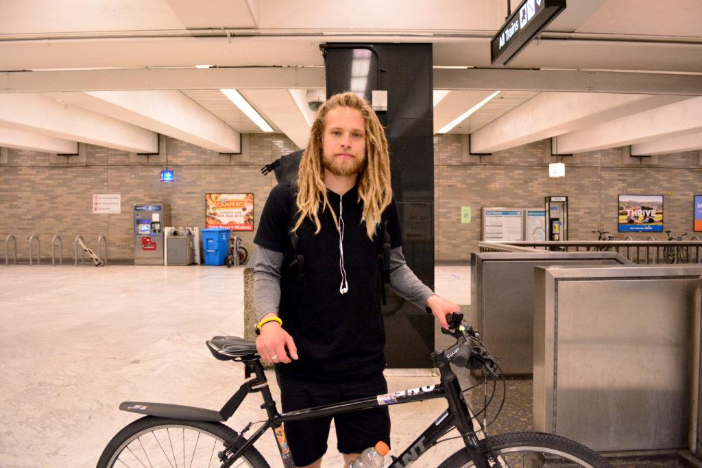 Cameron Scott, a cyclist and delivery employee, has to take an alternative route due to the closure of Civic Center Bart station in San Francisco on Tuesday, March. 13, 2018. (Bryan Ramirez/Golden Gate Xpress)