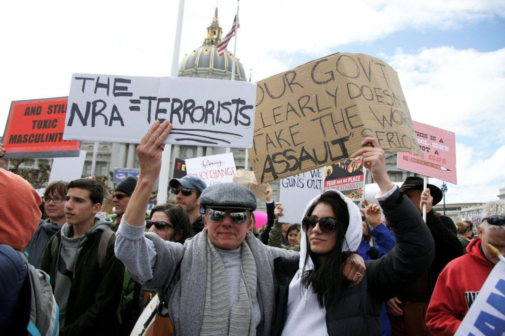 Pilar Sinelnikoff, left, and Ariana Sinelnikoff start walking towards Embarcadero in San Francisco after the march for our lives rally on Saturday, March. 24, 2018. (Aya Yoshida / Golden Gate Xpress)