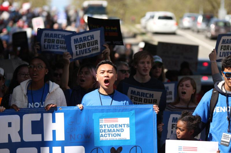Richmond High school sophomore Ryan Saechao yells in protest to gun violence and mass shootings during the March for Our Lives march on Barrett Avenue in Richmond, Calif., on Saturday, March 24, 2018. (Christian Urrutia/Golden Gate Xpress)