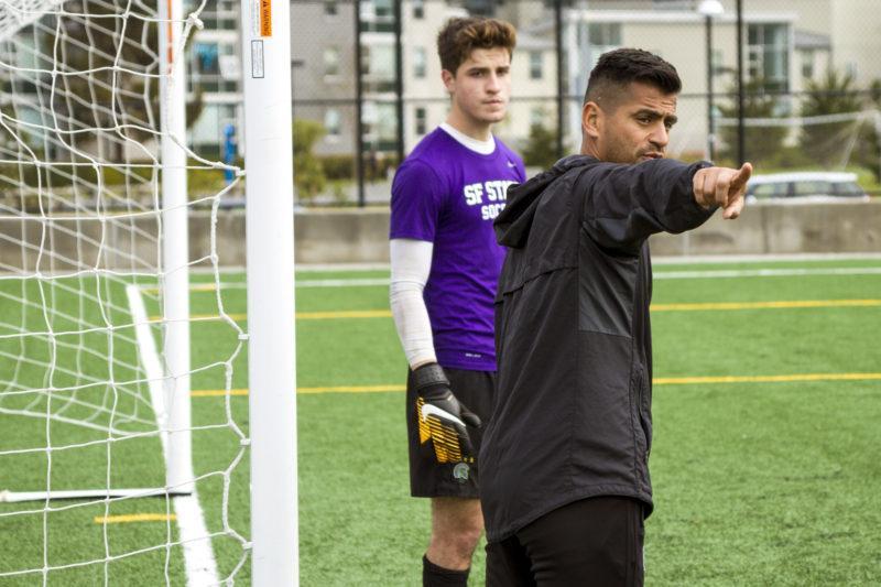 Head Coach Javier Ayala-Hil,right, works with goalkeeper Erik Ornelas, left, in between corner kicks at the Men