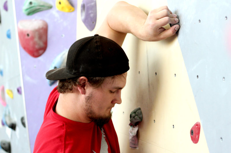 Civil engineering major Mitchell Ingles prepares to climb the rock wall in the Mashouf Wellness Center at SF State on Monday, April 9, 2018. (Christian Urrutia/Golden Gate Xpress)