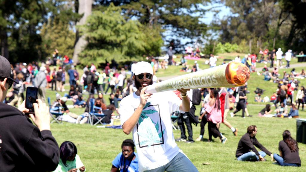Promoter for Weed maps Chris J. blowing up a joint at the 420 event at Hippie Hill on April 20. 2018 (Golden Gate Express)