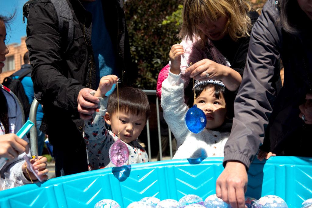 Two children who's parents chose not to disclose their names, gather around one of the many inventive games at that are available for children at the 2018 Cherry Blossom Festival in San Francisco on Saturday, Apr. 15, 2010. (David Rodriguez/Golden Gate Xpress)