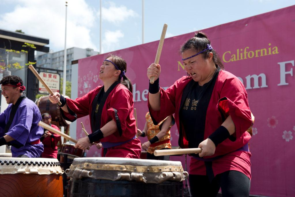 Jennifer Fong, left, perform along side her sister Michelle Fong and other members of the San Francisco Taiko dojo at the 2018 Northern California Cherry Blossom in San Francisco on Saturday, Apr. 15, 2010. (David Rodriguez/Golden Gate Xpress)