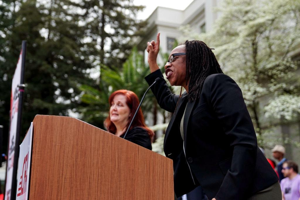 Lateefah Simon, CSU Board of Trustees member and program director for the Rosenberg Foundation, leads a protest aimed at singling out Governor Jerry Brown at the State Capitol on Wednesday, April 4, 2018. (Amarah Hernandez/Golden Gate Xpress)