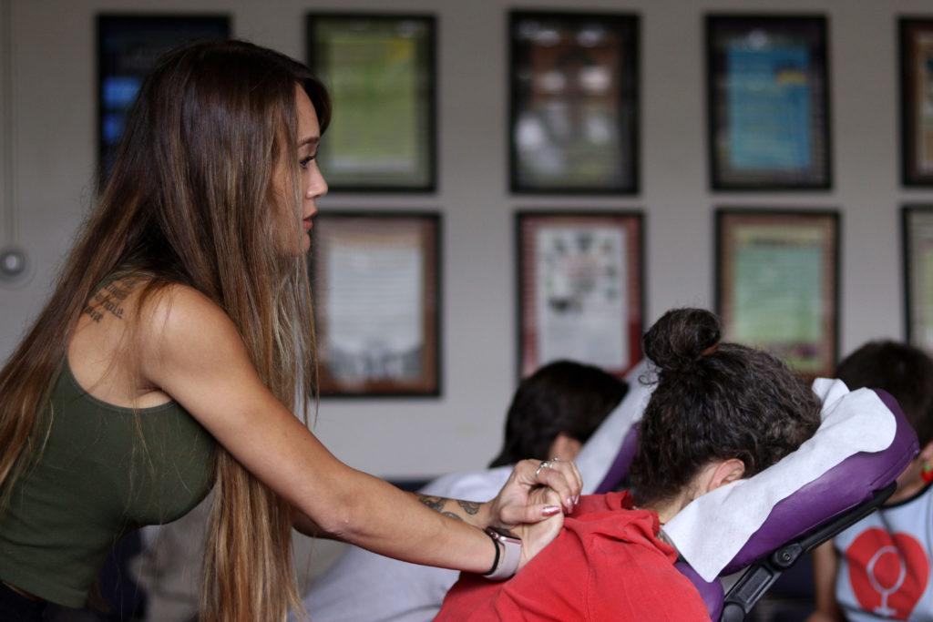 Miho Byrn massages in room 329 of the HSS Building at SF State on Wednesday, Mar. 14, 2018. (Oscar Rendon/GoldenGateXpress)