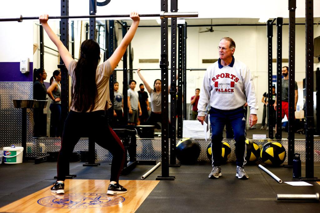 Jim Schmitz, former team USA Olympic weightlifting coach, teaches students proper lifting form during the barbell basics and weightlifting workshop seminar on Thursday April 12, 2018. (Niko LaBarbera/Golden Gate Xpress)