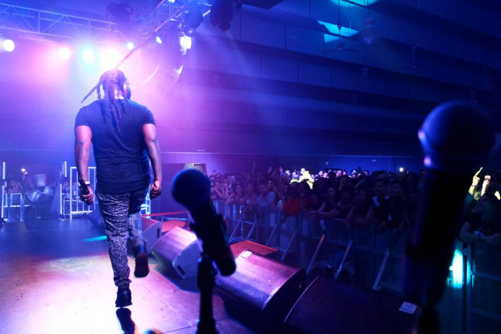 T-pain dancing on stage at the 8th Annual Rhythms Music Festival at SF State on Saturday April 14th in San Francsico. (Diego Aguilar/Golden Gate Xpress)