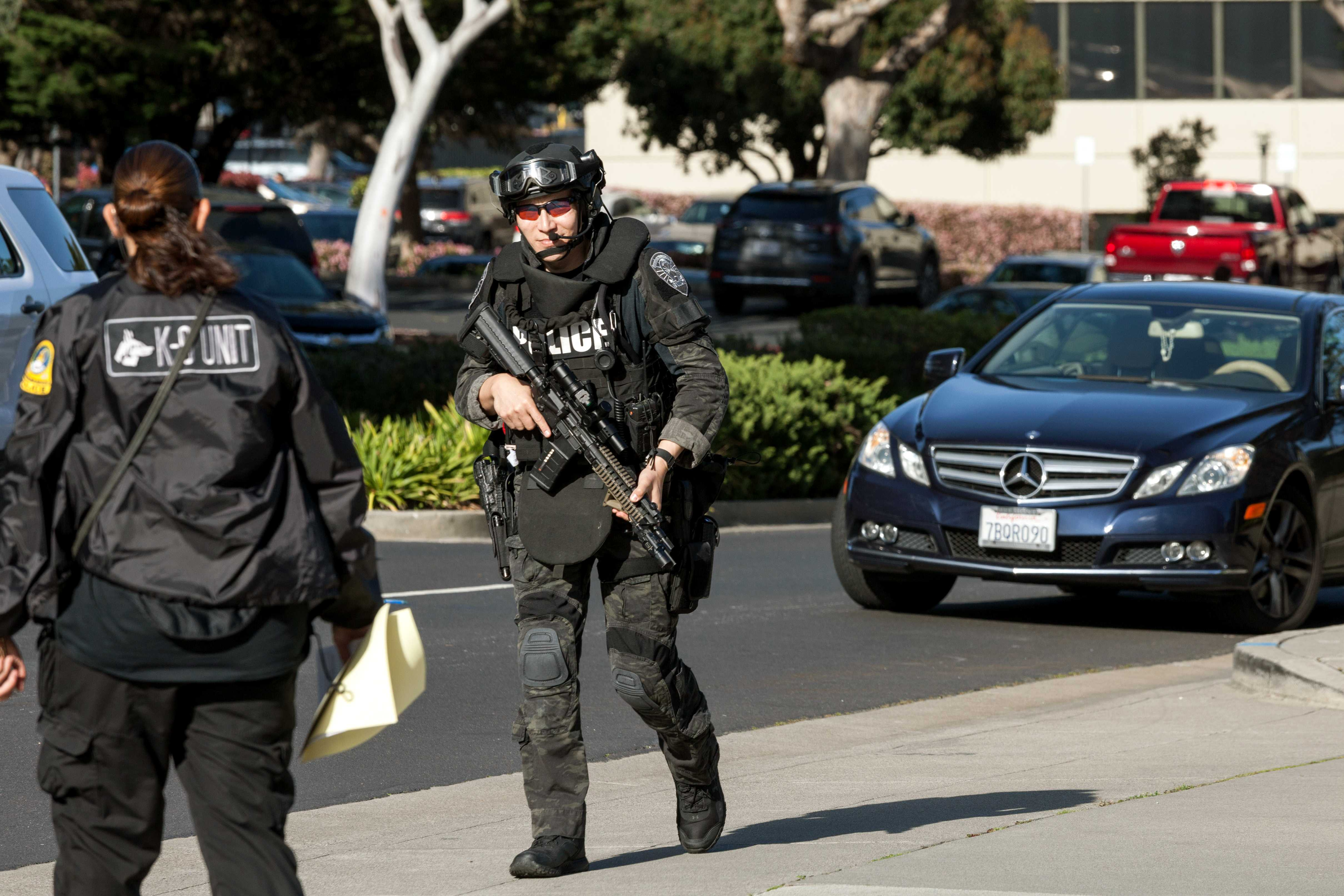 Armed officers present after the shooting incident at YouTube headquarters in San Bruno, Calif. (Photo by Garrick Wong)