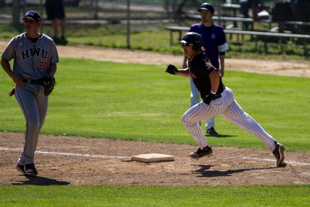 SF State's Jordan Abernathy (10) rounds first base after his hit during the baseball game against Holy Names University at Maloney Field at SF State on Monday, April 2, 2018. (Joey Vangsness/Golden Gate Xpress)