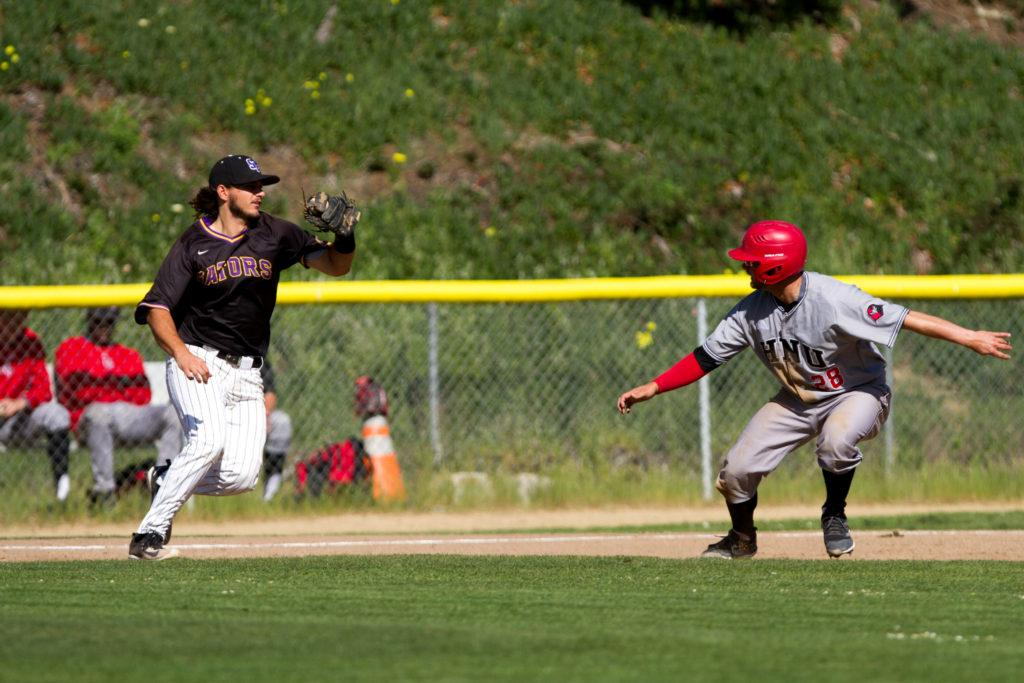 SF State third baseman Antone Self (20) chases down Holy Names University catcher Zachary Bartelme to get the out at Maloney Field at SF State on Monday, April 2, 2018.