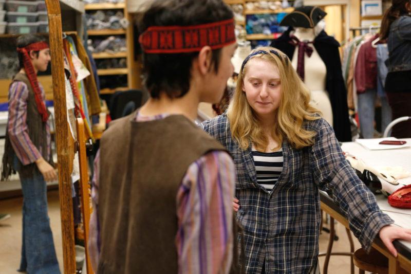Student costume designer  prepares for production