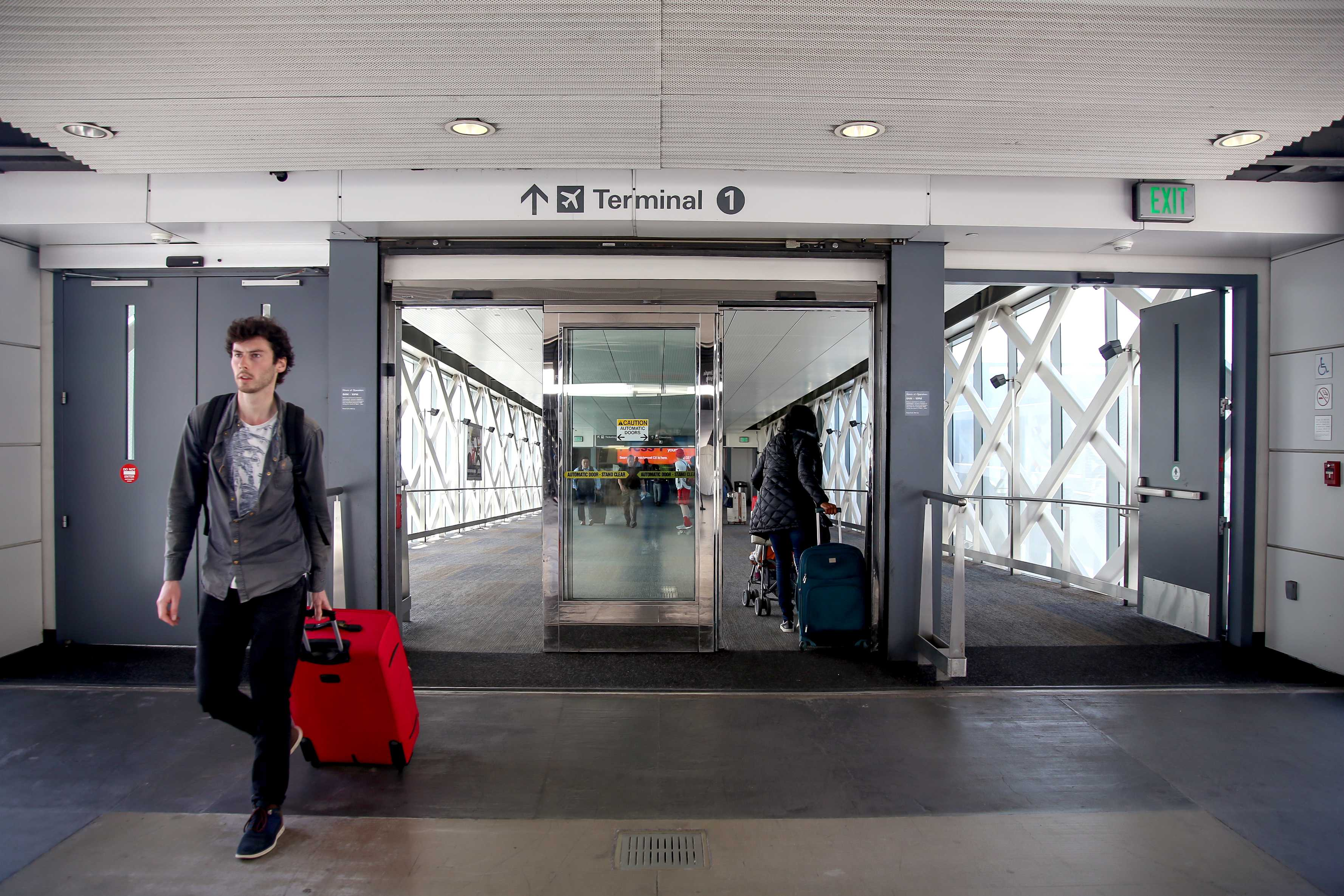Travelers enter and leave Terminal 1 at San Francisco International Airport on April 3. Terminal 1 is currently underway to being renamed to