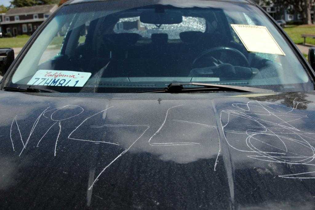 A car is seen as it was vandalized at Juan Bautista Circle near Fuente Avenue in the Parkmerced neighborhood close to SF State on Wednesday, May 16, 2018. The act of destruction seems to be racially motivated.  (Christian Urrutia/ Golden Gate Xpress)