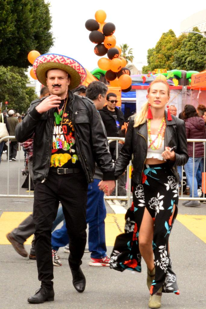 A couple dresses up in costumes during the Cinco de Mayo Block Party festivities taking place on Valencia Street, in San Francisco on Saturday, May 5, 2018. (Bryan Ramirez/Golden Gate Xpress)