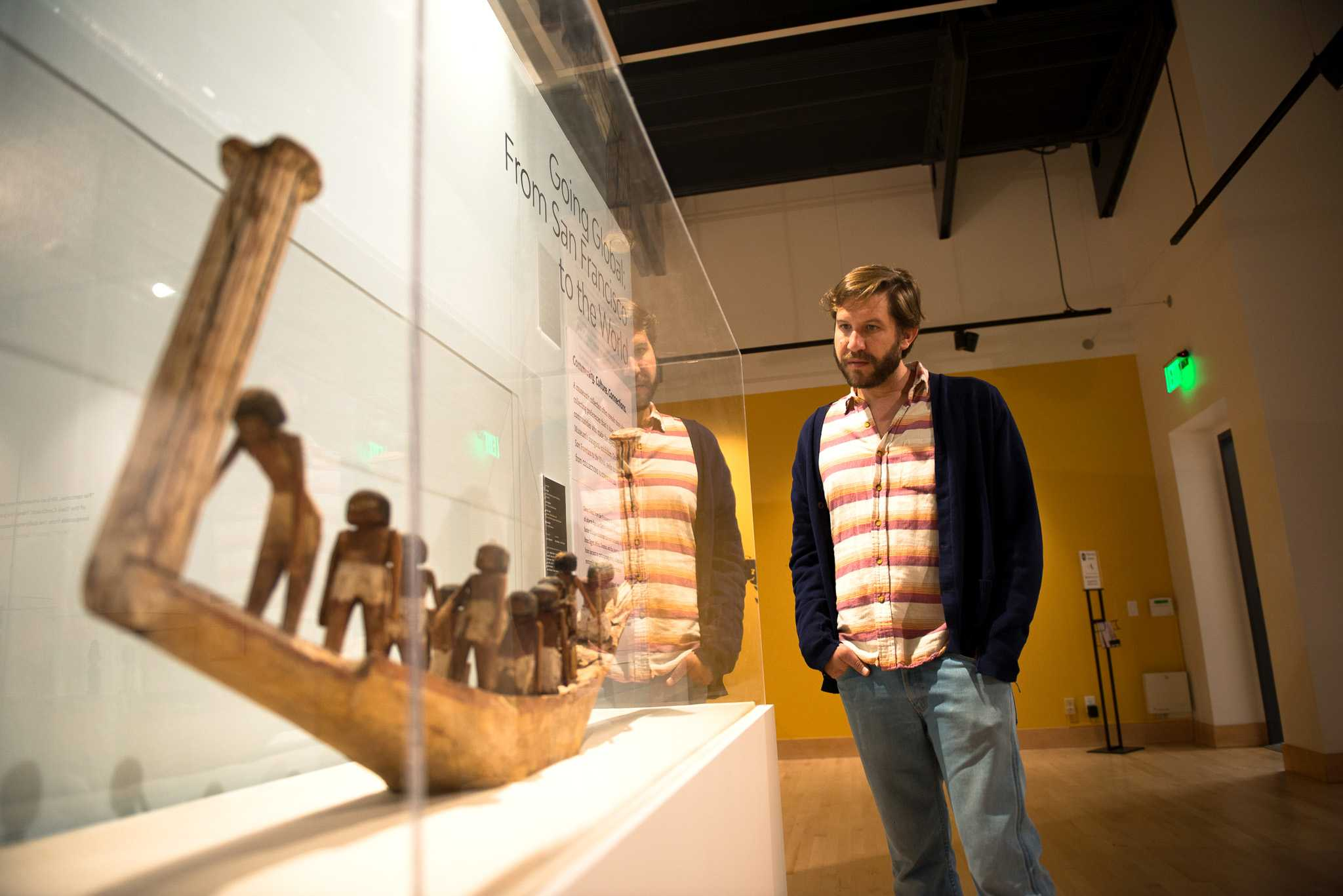 Teddy Albiniak, director of forensics at San Francisco State University is looking at one of the exhibits featured at the Going Global art exhibit that is located in the Global Museum inside the fine arts building on Thursday, Apr. 26, 2018. (David Rodriguez/Golden Gate Xpress)