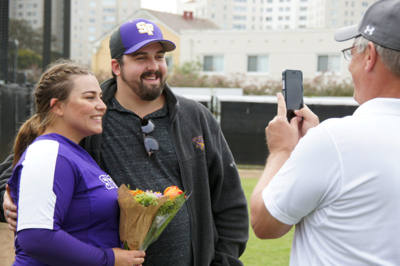 SF State outfield Delanie Chrisman(14) and Alex DeMenno are photographed before the Senior Day's game versus Chico State on Saturday, April 28, 2018. (Aya Yoshida/Golden Gate Xpress)