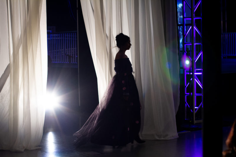 A model emerges from backstage to begin the walk down the runway during Runway 2018: Diverge on Thursday, May 2018.