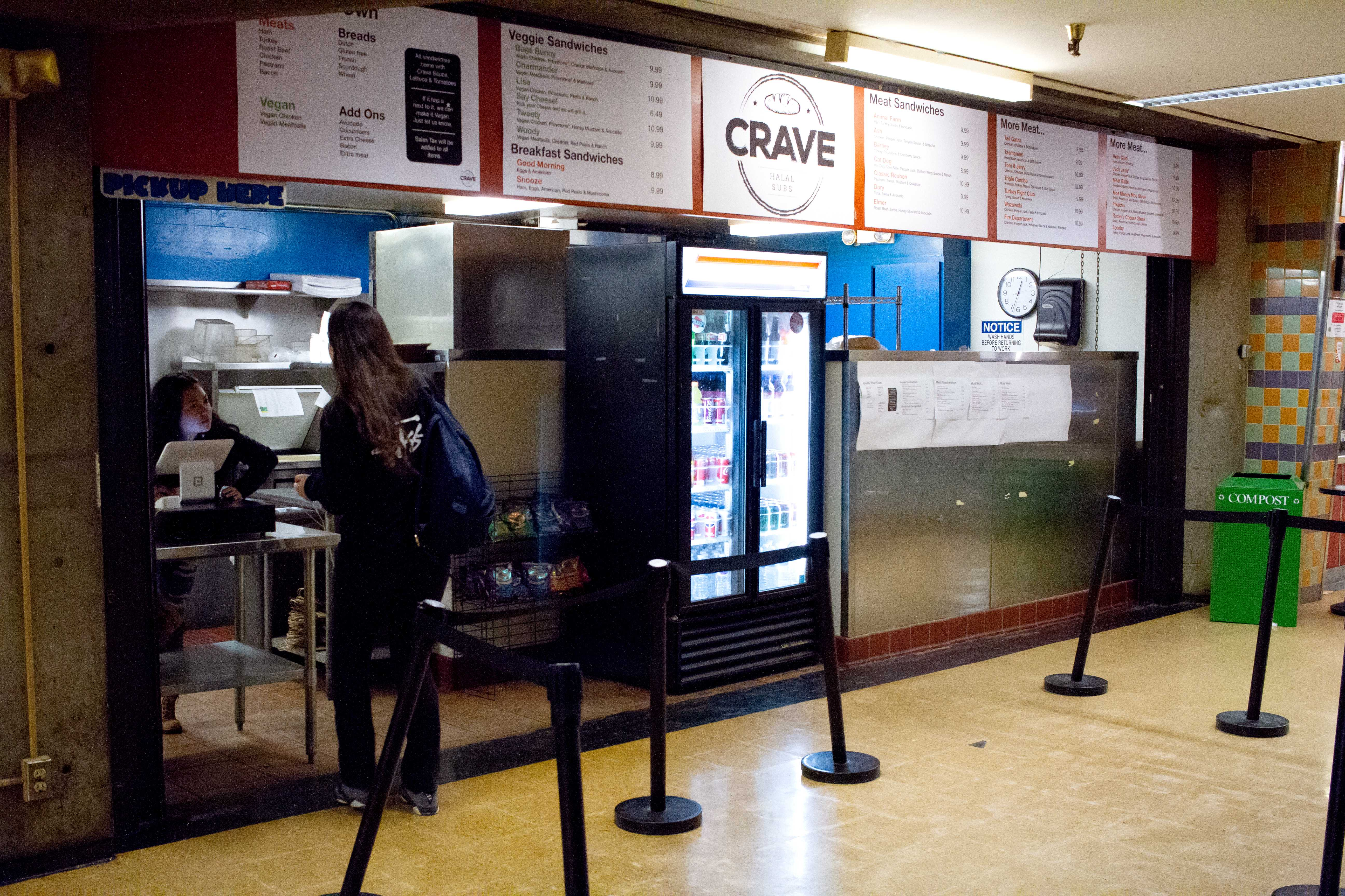 A student places an order at Crave Halal Sandwiches in the basement of the Cesar Chavez building on Monday, Apr. 30, 2018.