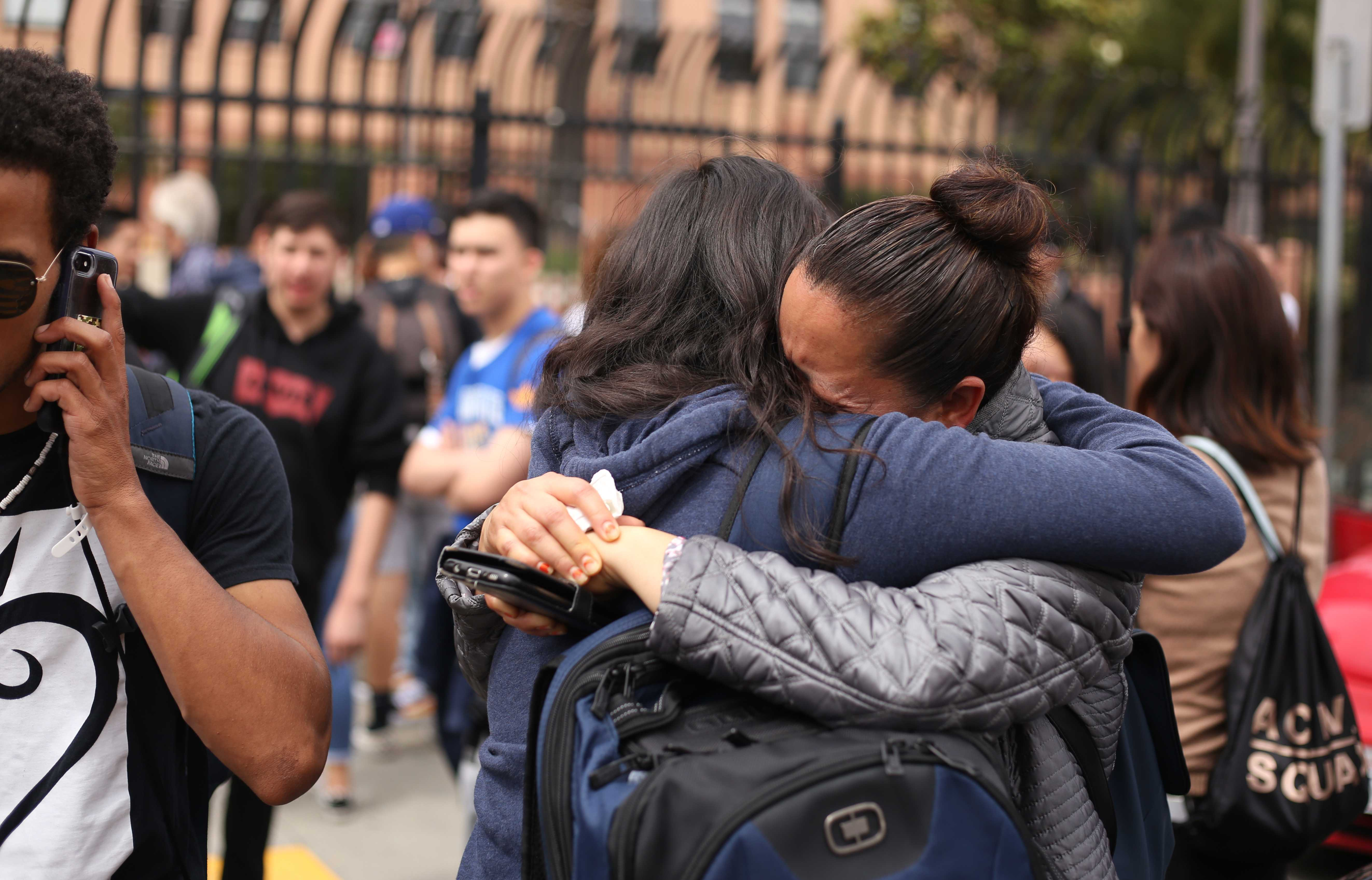 Balboa High School student Carolina Mendiola and her mother Teresa embrace after Carolina was released from the school following a lockdown due to reports of a shooting on campus in San Francisco, Calif., on Thursday, Aug. 30, 2018. (Christian Urrutia/Golden Gate Xpress)