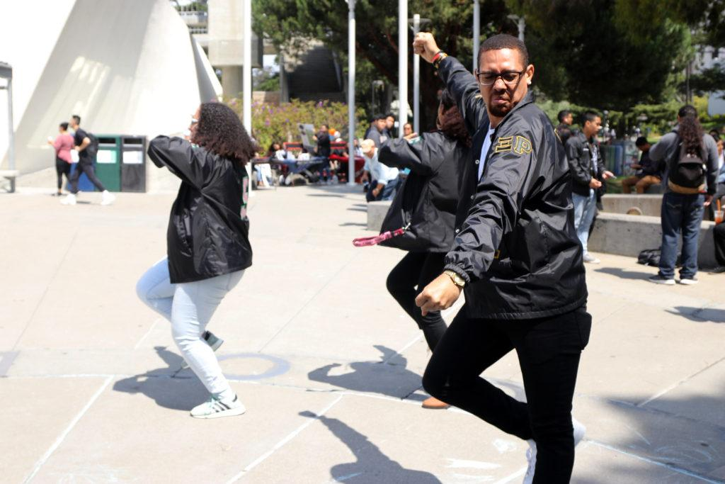 Ryan Webb, 22 (right), Chantel Heard, 22, and Marissa Suttles, 21, dance at the Malcolm X Plaza at on the first day of class Monday, August 27, 2018. (Oscar Rendon/Golden Gate Xpress)