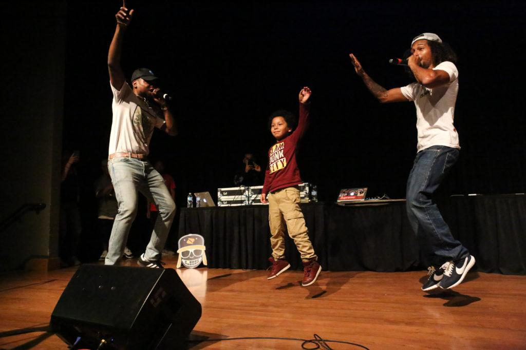 Ismael Peña, age 8, dances on stage with Los Rakas at San Francisco State University's Jack Adams Hall on Thursday, August 30th, 2018. The concert event, put on by Associated Students, took place from 6-9 PM and featured multiple performers. (Mira Laing/Golden Gate Xpress)