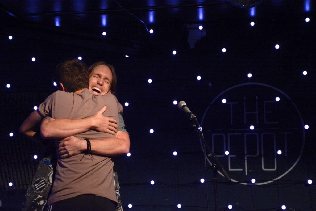 Seanan Kenney hugs host Tyler David Daguerre after his comedy set at The Depot on Wednesday, Sept. 5. (Tristen Rowean/Golden Gate Xpress)
