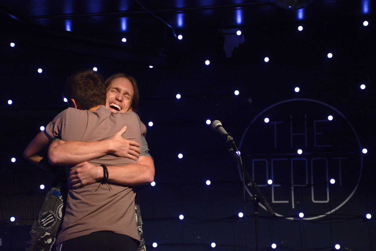 Seanan Kenney hugs host Tyler David Daguerre after his comedy set at The Depot on Wednesday, Sept. 5. (Tristen Rowean/Golden Gate Xpress)