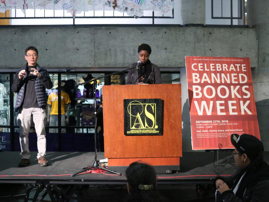 A+student+%28right%29+speaks+about+their+favorite+poems+at+the+%E2%80%9CBanned+Books%E2%80%9D+event+held+at+the+Caesar+Chavez+Student+Center+on+Thursday%2C+Sept.+27th%2C+2018.+%28Evan+Moses%2F+Golden+Gate+Xpress%29
