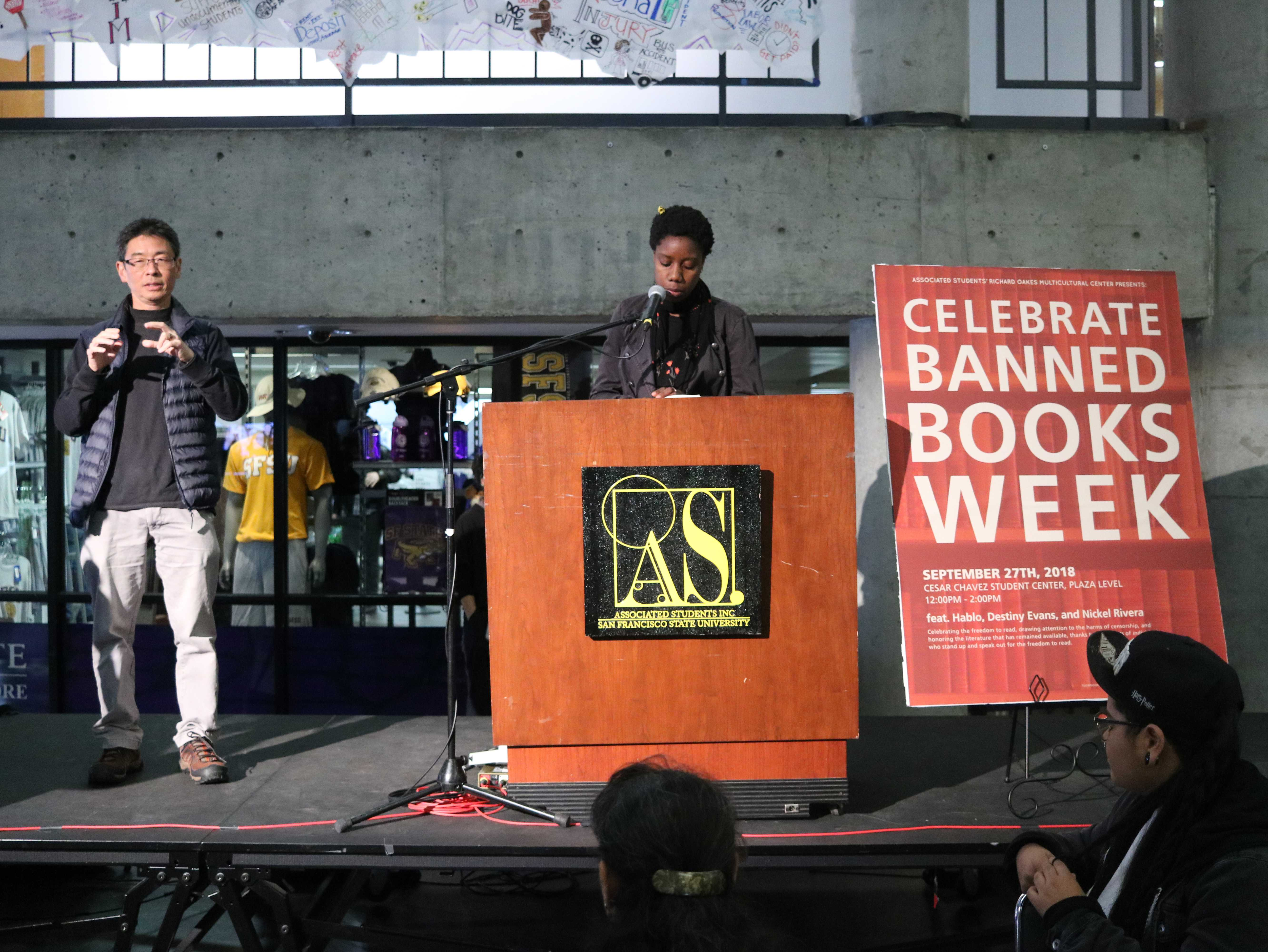 """A student (right) speaks about their favorite poems at the """"Banned Books"""" event held at the Caesar Chavez Student Center on Thursday, Sept. 27th, 2018. (Evan Moses/ Golden Gate Xpress)"""