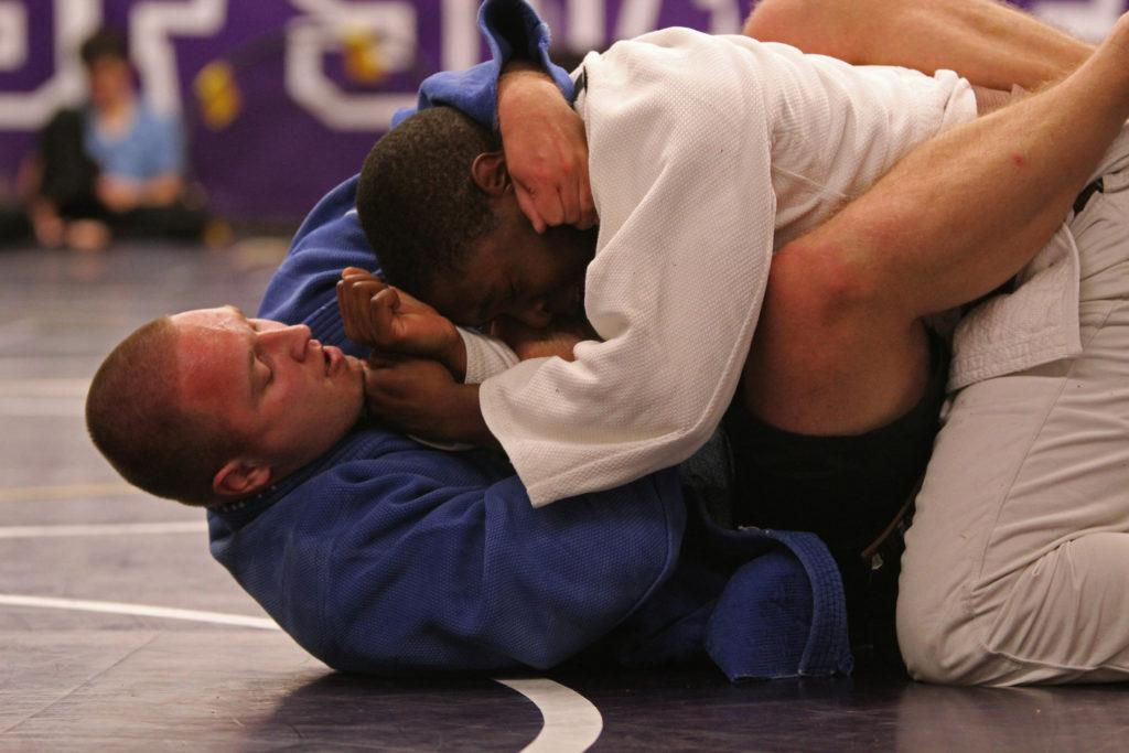 Judo Club members Yevgeniy Sosnovskiy (bottom) grapples with Nicholas Mitchell during the club's practice session in Gym-149 on Wednesday, March 5, 2018. (Christian Urrutia/Golden Gate Xpress)