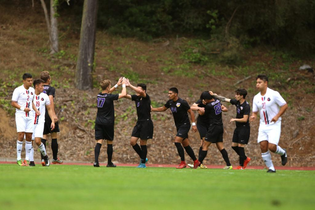 The SF State Gators celebrate scoring within the first couple minutes of their game against Holy Names University at Cox Stadium in San Francisco, Calif. on Thursday, Sept. 6, 2018. The game ended in a 1-1 draw. (Mira Laing/Golden Gate Xpress)