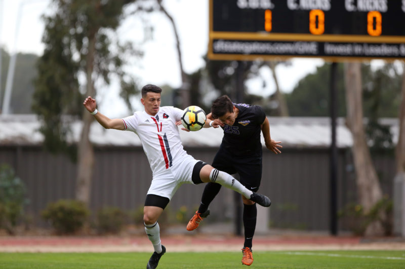 SF State defender Miles Burditt (25) jumps up to head the ball away from an opposing player during the men's soccer game against Holy Names University at Cox Stadium in San Francisco, Calif. on Thursday, Sept. 6, 2018. The game ended in a 1-1 draw. (Mira Laing/Golden Gate Xpress)