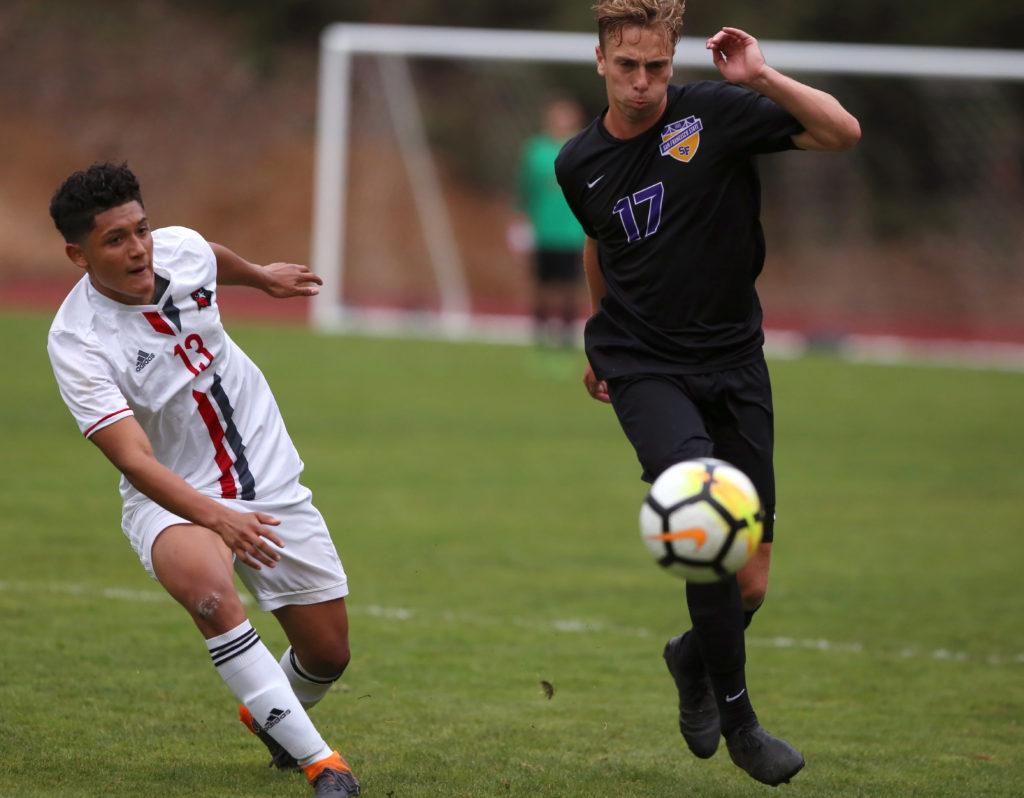 SF State midfielder Gustav FInk (17) races to gain possession of the ball during the men's soccer game against Holy Names University at Cox Stadium in San Francisco, Calif. on Thursday, Sept. 6, 2018. The game ended in a 1-1 draw. (Mira Laing/Golden Gate Xpress)