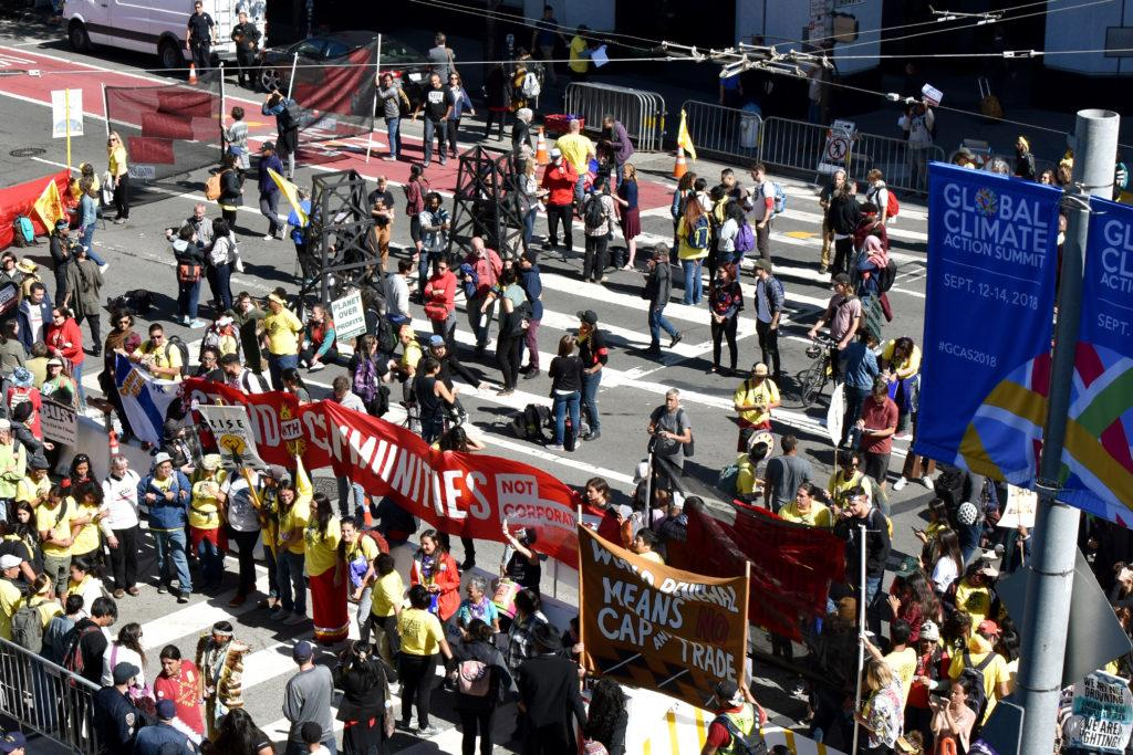 A crowd of protesters line up outside of Moscone Center in San Francisco, on Thursday, Sept. 13. Their protests urged Gov. Jerry Brown to take more action around climate change during his final year. (Kirk Stevenson/Golden Gate Xpress)