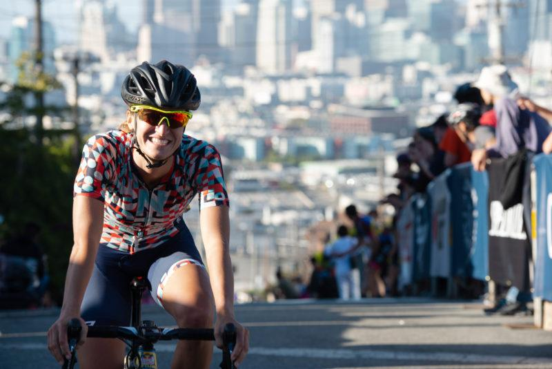 Hanna Muegge finishes with a big smile as she earns first place in the San Francisco Red Bull Bay Climb WomenÕs Open on Saturday, Sept. 8. (David Rodriguez/Golden Gate Xpress)