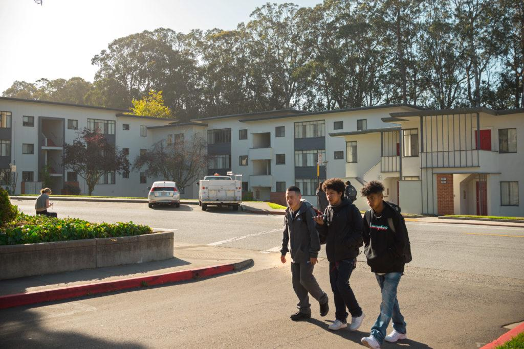 Pedestrians cross Buckingham Way in front of the proposed location for a 400-room hotel and conference center at SF State on Wednesday, Sept. 19, 2018. The new hotel is part of the Future State Vision Plan to renovate the campus and would generate profit for the university. Portions of student housing at University Park North would need to be demolished to make way for the hotel project. (Chris Robledo/Golden Gate Xpress)
