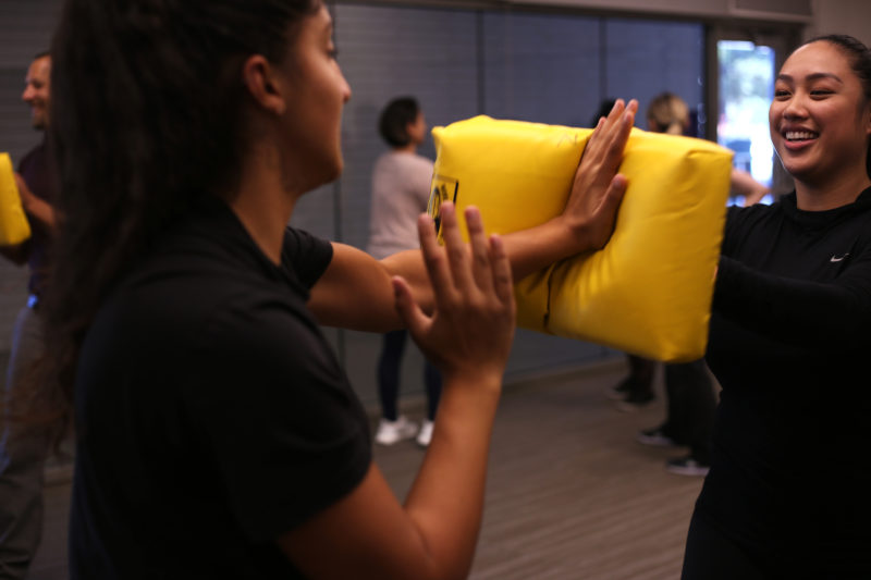 Biology major Shannon Changizi and Vanessa Mariano, a business management major, practice a striking technique during the self-defense workshop at the Mashouf Center on Wednesday, Sept. 19. (Christian Urrutia/Golden Gate Xpress)