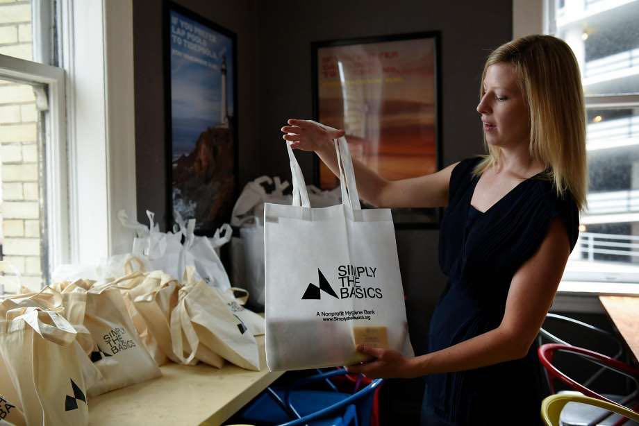 Meghan Freebeck, founder of Simply the Basics, fills bags with hygiene items to distribute. Credit: Meghan Freebeck