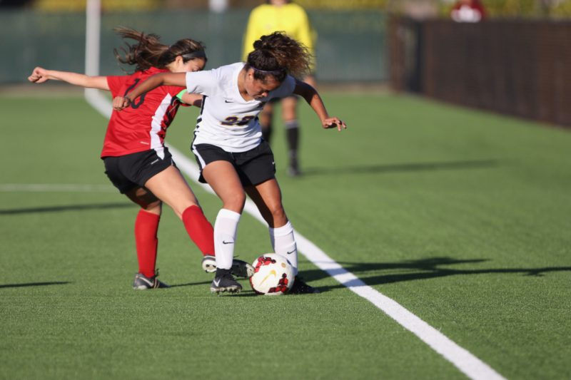 SF State center forward Karla Ramos (26) battles for the ball against Holy Names University Hawks at the Skyline soccer field in San Bruno on Sept. 19, 2018. (Oscar Rendon/Golden Gate Xpress)
