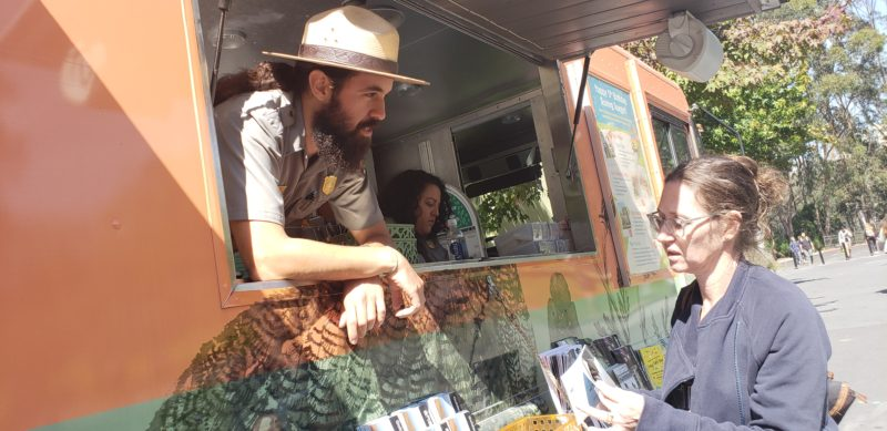 Rafael Vazquez, National Park Service education and outreach ranger, answers a question out of the Golden Gate National Park Conservancy information truck on Sept. 26, 2018 in front of the Student Services Building. (Lorenzo Morotti/Golden Gate Xpress)