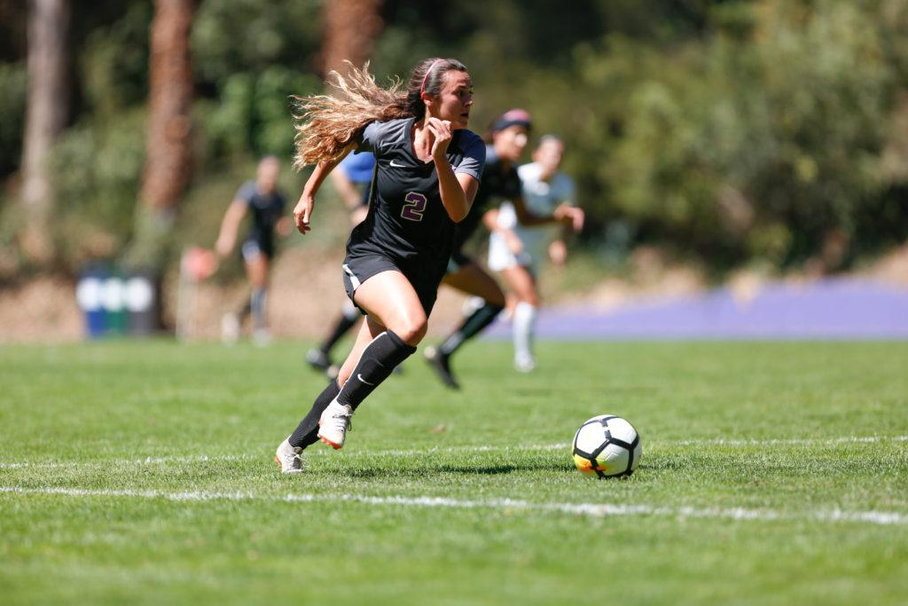 SF State midfielder Ana Williams races upfield after the opening kick off during the women's soccer home opener against Seattle Pacific on Saturday Sept. 8, 2018. (Niko LaBarbera/Golden Gate Xpress)
