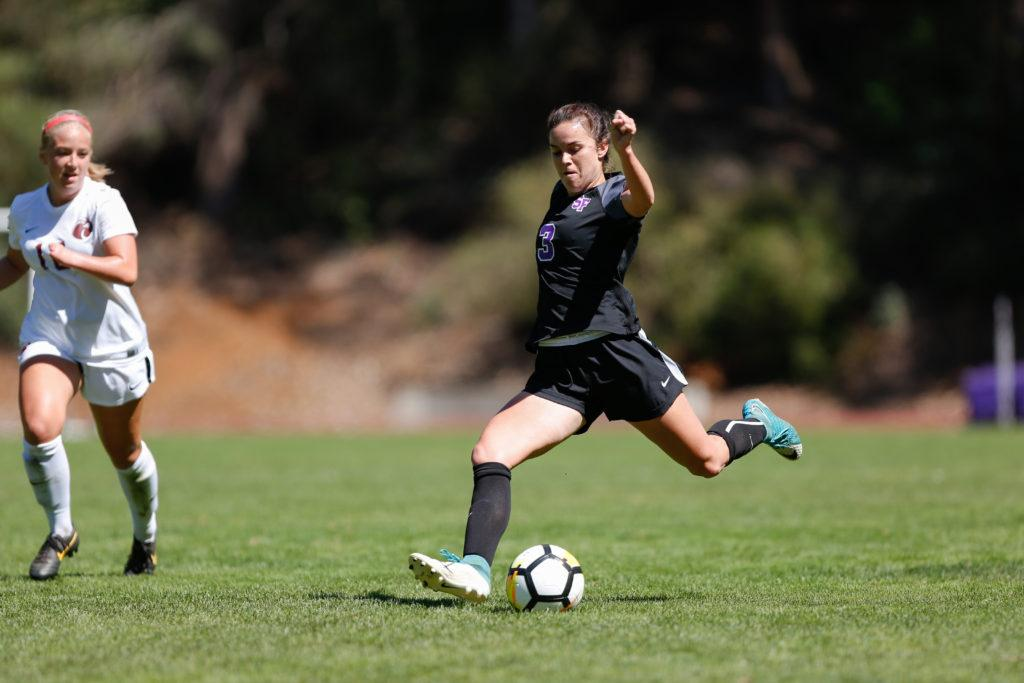 SF State defender Madison Messier kicks the ball upfield during the women's soccer home opener against the Seattle Pacific on Saturday Sept. 8, 2018. (Niko LaBarbera/Golden Gate Xpress)