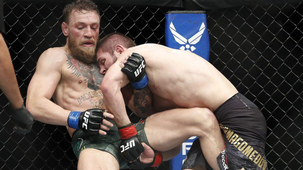 Khabib Nurmagomedov, right, tries to take down Conor McGregor during a lightweight title mixed martial arts bout at UFC 229 in Las Vegas, Saturday, Oct. 6, 2018. (AP Photo/John Locher)