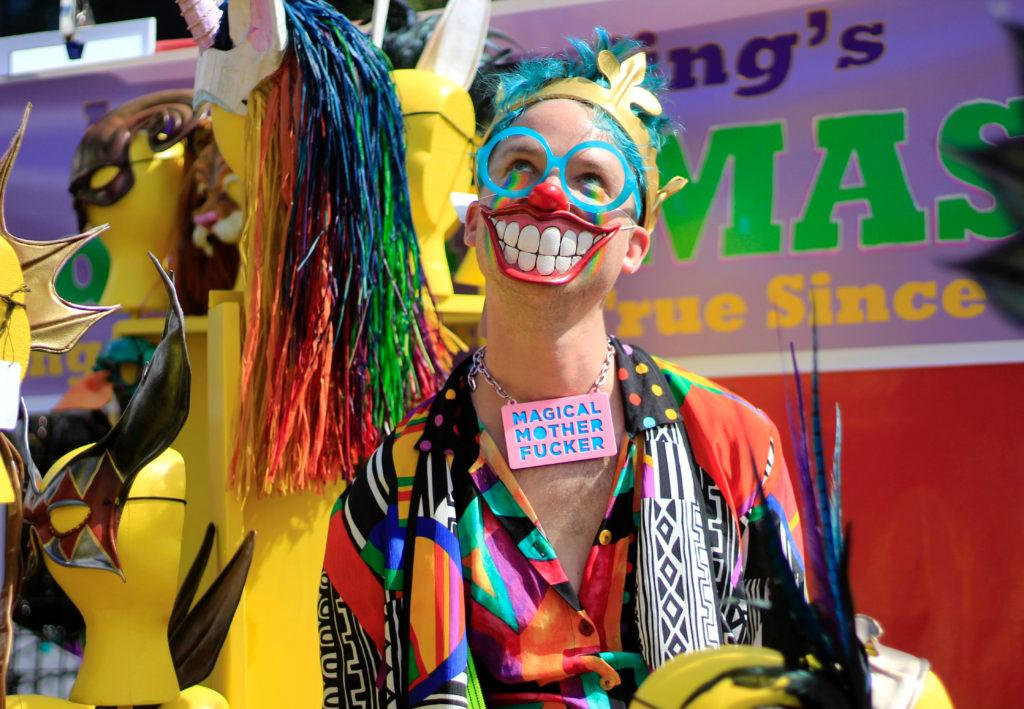 Lars Adams poses in a clown outfit as he sells items at his table at the Folsom Street Fair in San Francisco on Sunday, Sept. 30, 2018. (Lindsey Moore/Golden Gate Xpress)